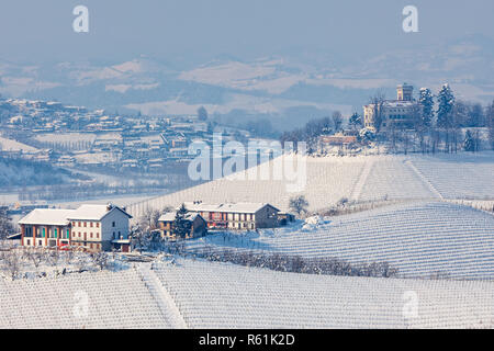 View of snowy hills and vineyards of Langhe region in Piedmont, Northern Italy. - Stock Photo