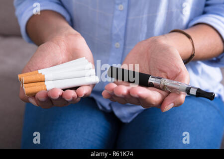 Woman Holding Electronic Cigarette - Stock Photo