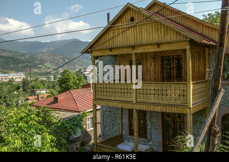Dilijan,Armenia,August 24,2018: View on the old resort town of Dilijan with wooden balconies and wrought iron gratings among of the mountains,covered  - Stock Photo