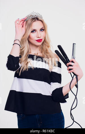 Portrait of smiling hairdresser with her work tools. - Stock Photo