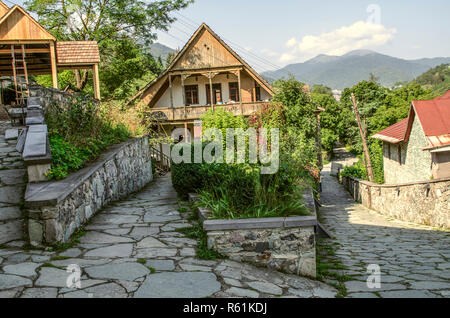 Dilijan,Armenia,August 24,2018:View of the intersecting cobbled streets with old stone houses with wooden balconies and wrought iron bars in the Tufen - Stock Photo