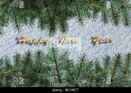 festive background with green fir tree branches over snow surface and text happy new year