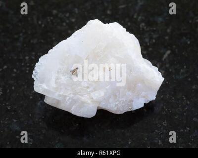 rough Baryte stone on dark background - Stock Photo