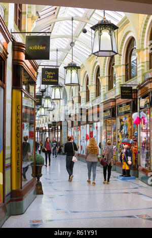Norwich arcade, view of people walking inside the Royal Arcade in Norwich city centre, Norfolk, UK - Stock Photo