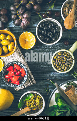 Concept of Mediterranean cuisine. Different fruit , herbs and appetizers on the  wooden table vertical - Stock Photo