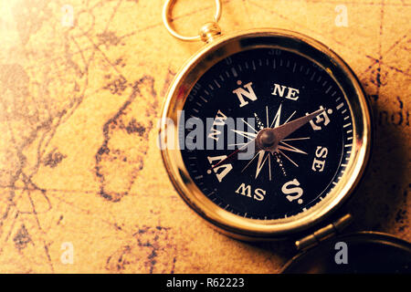 golden compass on old treasure map - Stock Photo