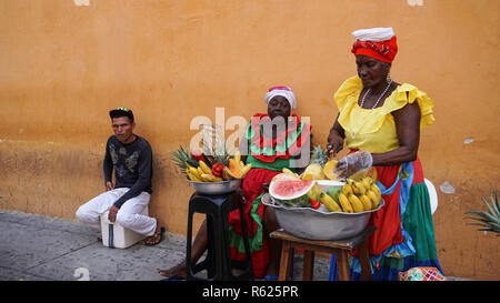 Colombian fruit seller in the historic center of colonial Cartagena, Colombia, South America - Stock Photo