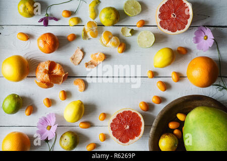 Citrus mix on the white wooden background  horizontal - Stock Photo