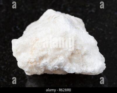 raw anhydrite stone on dark - Stock Photo