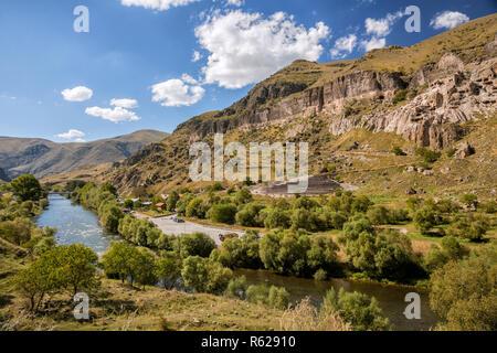 Kura River and ancient cave monastery Vardzia in Georgia - Stock Photo
