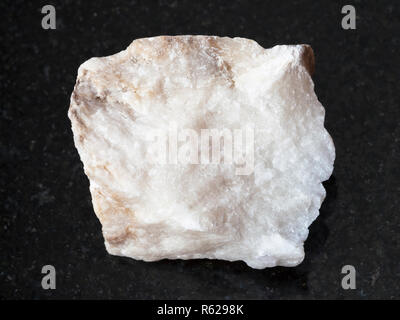 rough Anhydrite stone on dark background - Stock Photo