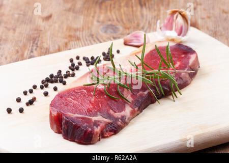 dry age steak on wood - Stock Photo