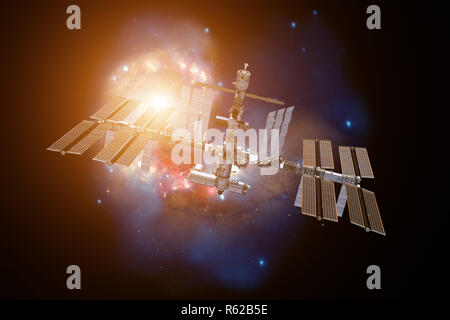 International Space Station over a galaxy. - Stock Photo