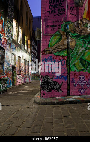Melbourne, Australia-October 23,2018: Local fashion serves dinners to hipsters in the alley Hosier Lane. - Stock Photo
