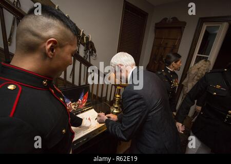 The Honorable Jack W. Bergman, United States representative, Michigan's 1st Congressional District, signs a guest book after an evening parade at Marine Barracks Washington, Washington, D.C., May 05, 2017. Evening parades are held as a means of honoring senior officials, distinguished citizens and supporters of the Marine Corps. - Stock Photo