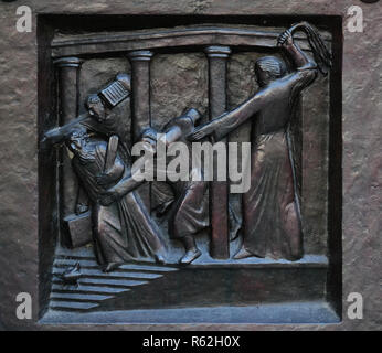 Christ Driving the Merchants from the Temple, relief on the door of the Grossmunster ('great minster') church in Zurich, Switzerland - Stock Photo