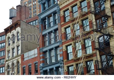 Architecture in New York City, USA, apartment houses, exterior design, fire escape stairs, day - Stock Photo