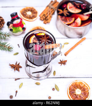 mulled wine in a glass with an iron cup holder - Stock Photo
