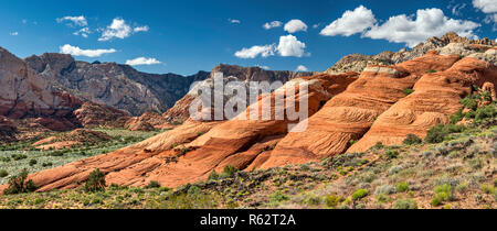 Crossbedded Navajo Sandstone rocks, West Canyon in distance, seen from Lava Flow Trail at Snow Canyon State Park, Utah, USA - Stock Photo