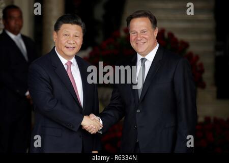 China's President Xi Jinping (L) greets Panama's President Juan Carlos Varela (R) before a meeting at the Presidential Palace in Panama City, Panama, on 3 December 2018. EFE/Bienvenido Velasco - Stock Photo
