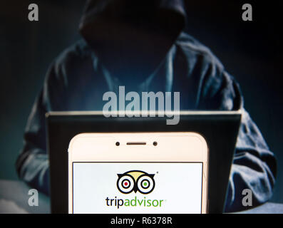 Hong Kong, China. 23rd Nov, 2018. American travel agency and restaurant website company TripAdvisor logo is seen on an Android mobile device with a figure of hacker in the background. Credit: Miguel Candela/SOPA Images/ZUMA Wire/Alamy Live News - Stock Photo