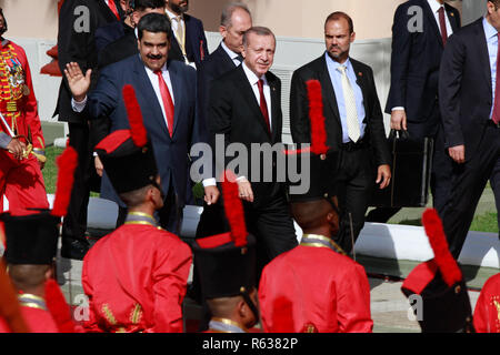Caracas, Venezuela. 03rd Dec, 2018. The Turkish head of state Recep Tayyip Erdogan (M) is welcomed by the Venezuelan president Nicolas Maduro (l) in the presidential palace Miraflores. Recep Tayyip Erdogan is on a one-day official visit to Venezuela after attending the G20 summit in Argentina. Credit: Boris Vergara/dpa/Alamy Live News - Stock Photo