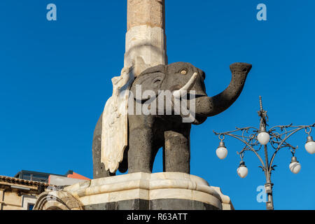 Stone elephant figure part of the Elephant Fountain (Fontana dell'Elefante) on Cathedral Square. Catania, Sicily, Italy - Stock Photo