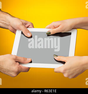 female teen hands using tablet pc with black screen, isolated - Stock Photo