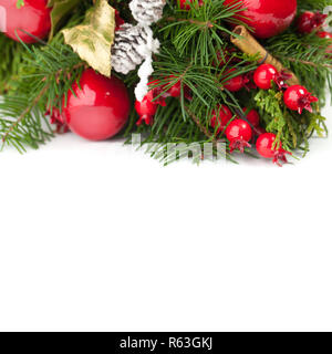 Christmas decoration with green spruce twig on white background - Stock Photo