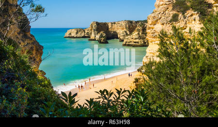 tourists at praia da marinha in pre-season, praia da marinha, high-angle view, caramujeira, algarve, portugal - Stock Photo