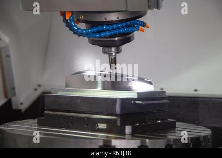 CNC milling machine cutting workpiece, industrial machining - Stock Photo