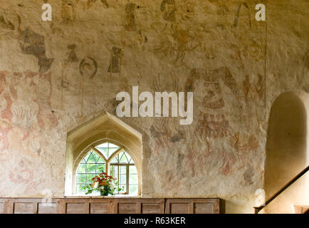 North Wall interior, Oddington, Glos. showing part of the doom painting to the left and the early 16th Century 'Magnificence' painting to the right. - Stock Photo