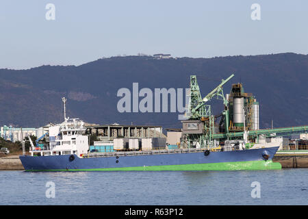 Cargo ship docked in the port    - Stock Photo