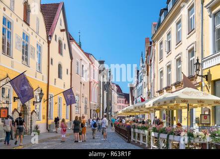 Cafes and shops on Pikk (Long Street) in the historic Old Town (Vanalinn), Tallinn, Estonia - Stock Photo