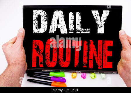 Daily Routine text written on tablet, computer in the office with marker, pen, stationery. Business concept for Accuracy Procedure white background with copy space - Stock Photo