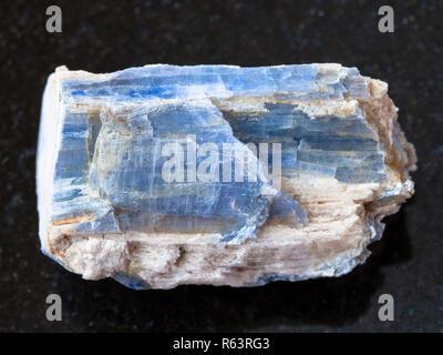 raw kyanite stone on dark background - Stock Photo