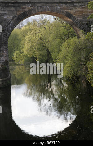 Viaduct arch reflection in water - Stock Photo