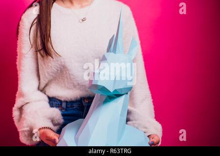 Fashion kid. Designer collection. White big unicorn origami made paper. Girl in beautiful pink dress. Studio shot. - Stock Photo