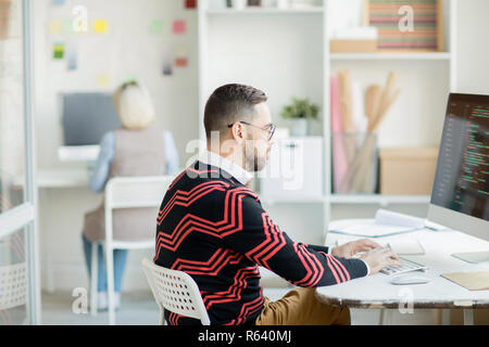 Concentrated on coding process - Stock Photo