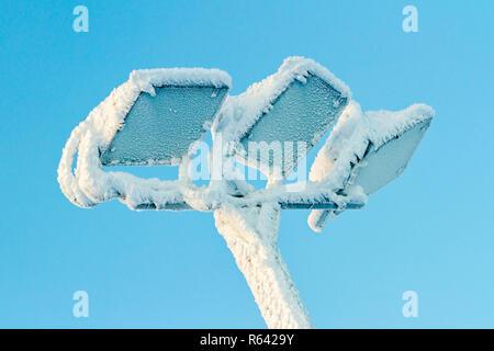 Morning winter hoarfrost on the outdoor lamp in ski resort Ruka, Finland. - Stock Photo