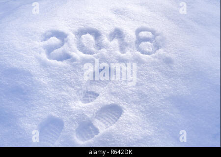 New Year 2018 greeting, footprints in snow, new year 2018, greeting card - Stock Photo