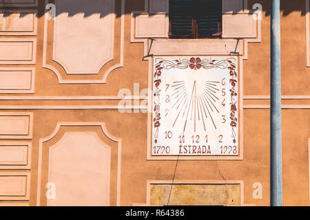 sundial on an old wall where it is written in Catalan - 1790 road 1998 - Stock Photo