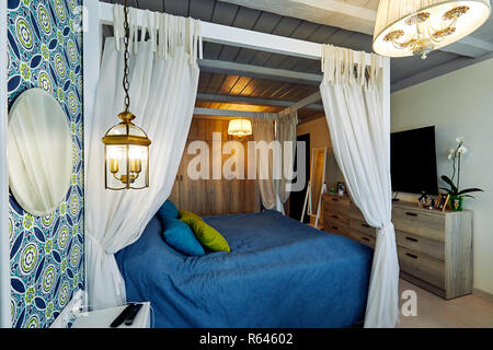 Moscow, Russia, 06.06.2018: Beautiful Furnished Bedroom with canopy in New Luxury Home - Stock Photo
