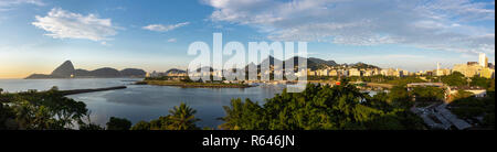 Beautiful panoramic view of the city of Rio de Janeiro with sugar loaf and corcovado at dawn. - Stock Photo