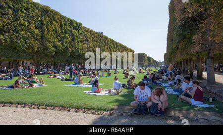 PARIS, FRANCE, SEPTEMBER 9, 2018 - Sit and relax at Luxembourg Gardens in a sunny and hot day of summer , Paris, France - Stock Photo