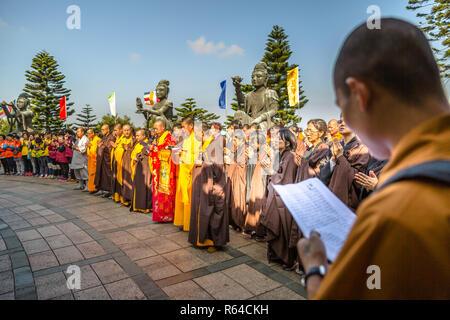 Hong Kong, China - December 11, 2016: A big crowd of Buddhist monks and faithful people at Big Buddha monastery, religious icon of Hong Kong. Praying together for Tian Tan Buddha on Lantau Island. - Stock Photo