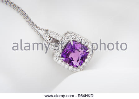 White gold pendant with rose violet amethyst and diamonds on soft  blurred background - Stock Photo