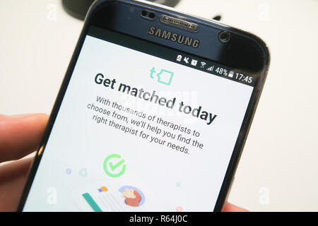 Image of the Talkspace app on a smartphone , get matched today - Stock Photo