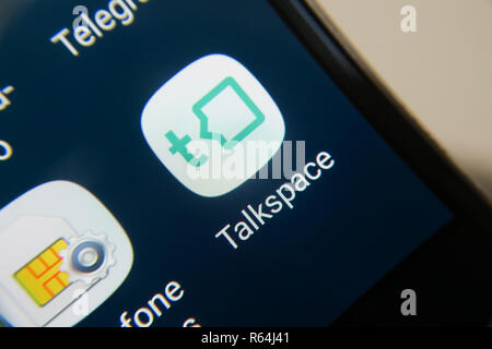 Image of the Talkspace app on a smartphone, button - Stock Photo