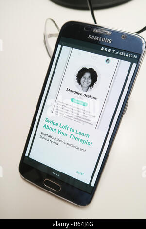 Image of the Talkspace app on a smartphone showing therapist - Stock Photo